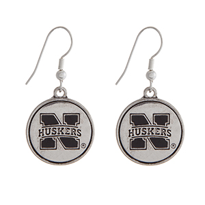 "Officially licensed University of Nebraska silver tone fishhook earrings with a circle logo. Approximately 2"" in length."
