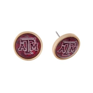 "Gold tone officially licensed Texas A&M University stud earrings. Approximately 2/3"" in length. Our exclusive design."