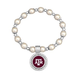Officially licensed pearl bead and silver tone stretch bracelet, featuring a silver tone medallion charm with Texas A&M center, accented with crystal clear rhinestones.