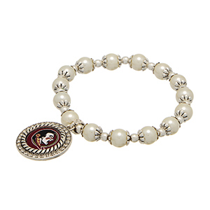 Officially licensed pearl bead and silver tone stretch bracelet, featuring a silver tone medallion charm with a FSU logo center, accented with crystal clear rhinestones.