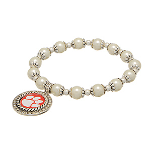 Officially licensed pearl bead and silver tone stretch bracelet, featuring a silver tone medallion charm with a Clemson Tigers logo center, accented with crystal clear rhinestones.