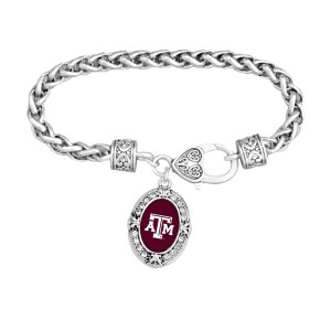 Silver tone officially licensed lobster clasp bracelet featuring the Texas A & M logo and clear crystal rhinestones.