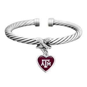 Silver tone officially licensed cuff bracelet featuring a heart shaped Texas A & M logo with clear crystal rhinestones.
