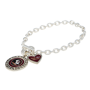 """Silver tone officially licensed toggle bracelet featuring the Florida State logo with clear crystal rhinestones and a charm inscribed with """"Fear the Spear""""."""