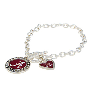 "Silver tone officially licensed toggle bracelet featuring the Alabama logo with clear crystal rhinestones and a charm inscribed with ""Roll Tide."""