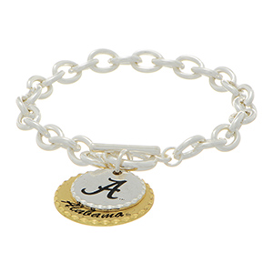 "Silver tone officially licensed collegiate toggle bracelet featuring two mixed metal disk stamped ""A"" and ""Alabama."" Approximately 7"" in length."