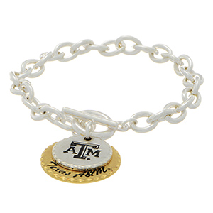 "Silver tone officially licensed collegiate toggle bracelet featuring two mixed metal disk stamped ""ATM"" and ""Texas A&M"". Approximately 7"" in length."