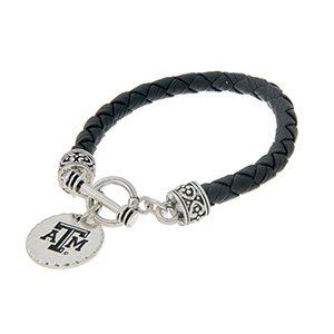"Black braided faux leather toggle bracelet with an officially licensed silver tone Texas A&M University charm. Approximately 7 1/2"" in length."
