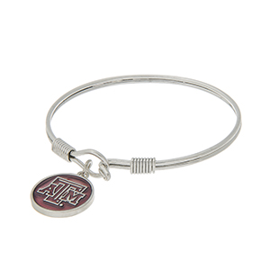 Silver tone latch bangle bracelet with a maroon officially licensed Texas A&M University charm.