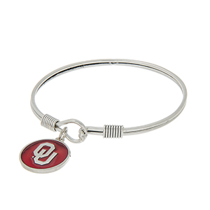 Silver tone latch bangle bracelet with a red officially licensed University of Oklahoma charm.
