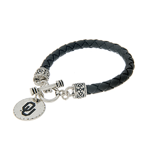 "Black braided faux leather toggle bracelet with an officially licensed silver tone University of Oklahoma charm. Approximately 7 1/2"" in length."