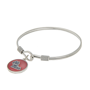 Silver tone latch bangle bracelet with a red and navy officially licensed Ole Miss charm.