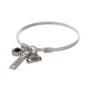 Officially licensed Louisiana State University silver tone bracelet with a purple rhinestone, logo, and Tigers stamped bar charm.