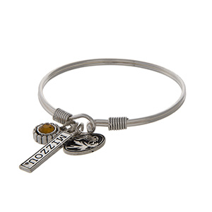 Officially licensed University of Missouri silver tone bracelet with a yellow rhinestone, logo, and Tigers stamped bar charm.