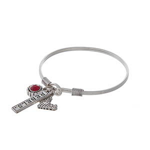 Officially licensed silver tone hook bracelet featuring a red rhinestone, Ole Miss logo, and a bar stamped with Rebels.