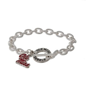 Silver tone officially licensed Ole Miss toggle bracelet with the logo charm.