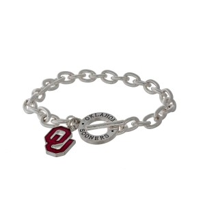 Silver tone officially licensed University of Oklahoma toggle bracelet with the logo charm.
