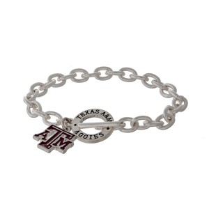 Silver tone officially licensed Texas A & M University toggle bracelet with the logo charm.