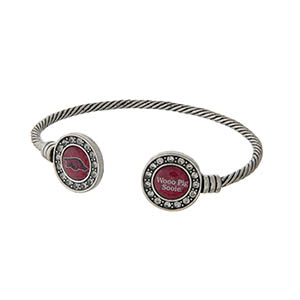 Officially licensed University of Arkansas silver tone open cuff bracelet.