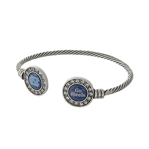 Officially licensed University of North Carolina silver tone open cuff bracelet.