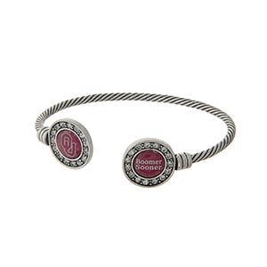 Officially licensed University of Oklahoma silver tone open cuff bracelet.