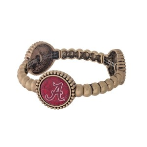 Officially licensed gold tone University of Alabama stretch bracelet with three stations. Our own exclusive design.