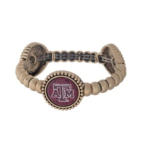 Officially licensed gold tone Texas A & M University stretch bracelet with three stations. Our own exclusive design.