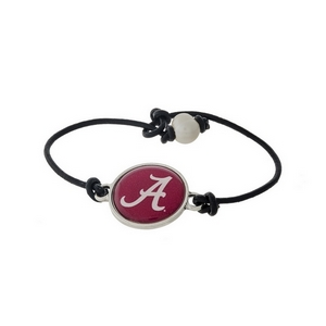 *Our Exclusive Design* Officially licensed University of Alabama, genuine leather cord bracelet with a freshwater pearl bead closure.