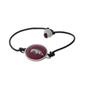 *Our Exclusive Design* Officially licensed University of Arkansas, genuine leather cord bracelet with a freshwater pearl bead closure.
