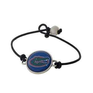 *Our Exclusive Design* Officially licensed University of Florida, genuine leather cord bracelet with a freshwater pearl bead closure.