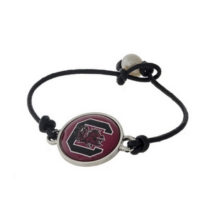 *Our Exclusive Design* Officially licensed University of South Carolina, genuine leather cord bracelet with a freshwater pearl bead closure.
