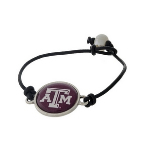 *Our Exclusive Design* Officially licensed Texas A & M University, genuine leather cord bracelet with a freshwater pearl bead closure.