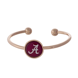 Officially licensed, rose gold tone cuff bracelet with the University of Alabama logo.