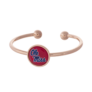 Officially licensed, rose gold tone cuff bracelet with the Ole Miss logo.