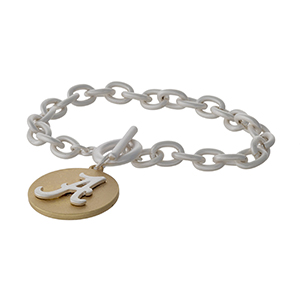 Officially licensed, two tone toggle bracelet with the University of Alabama logo charm.