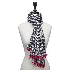 "Light weight houndstooth scarf that measures approximately 65"" x 14"" and features small red pom poms. 100% Polyester."