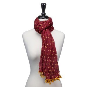 """Light weight maroon with yellow polka dots scarf that measures approximately 65"""" x 14"""" and features small pom poms. 100% Polyester."""